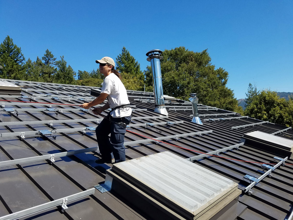 Redway, CA: Racking and micro inverters going in on a 40 kW grid-tied array on the Dazey's Supply building.