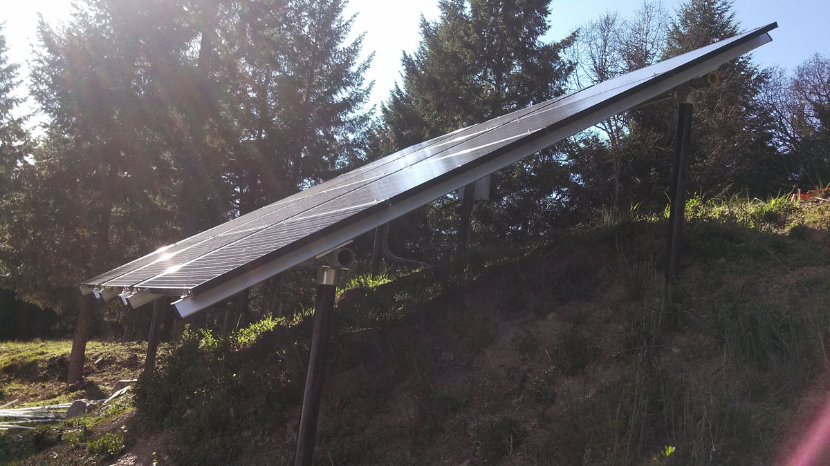 Orleans, CA: Putting a steep south-facing slope to use by installing solar for an off-grid farm.